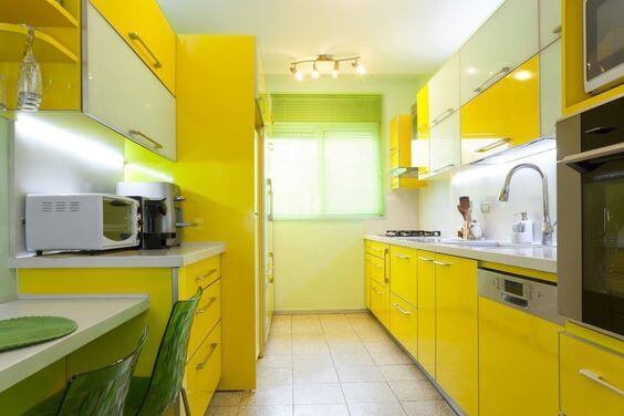 These bright yellow cabinets are sure to make your kitchen unique and colorful!