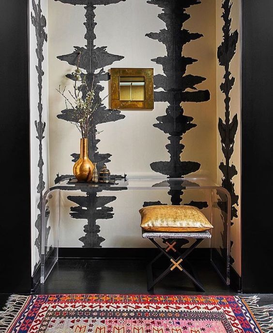 Don't be afraid to go bold with your entryway wallpaper!