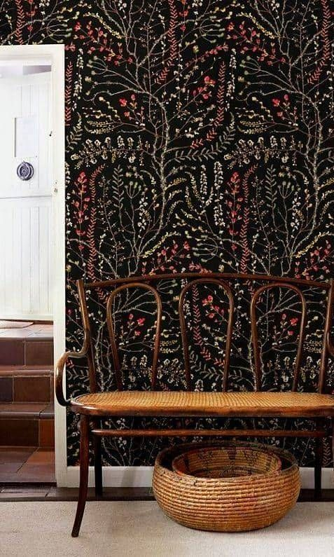 Dark wallpapers can look beautiful in your entryway if paired with traditional furniture and light flooring.