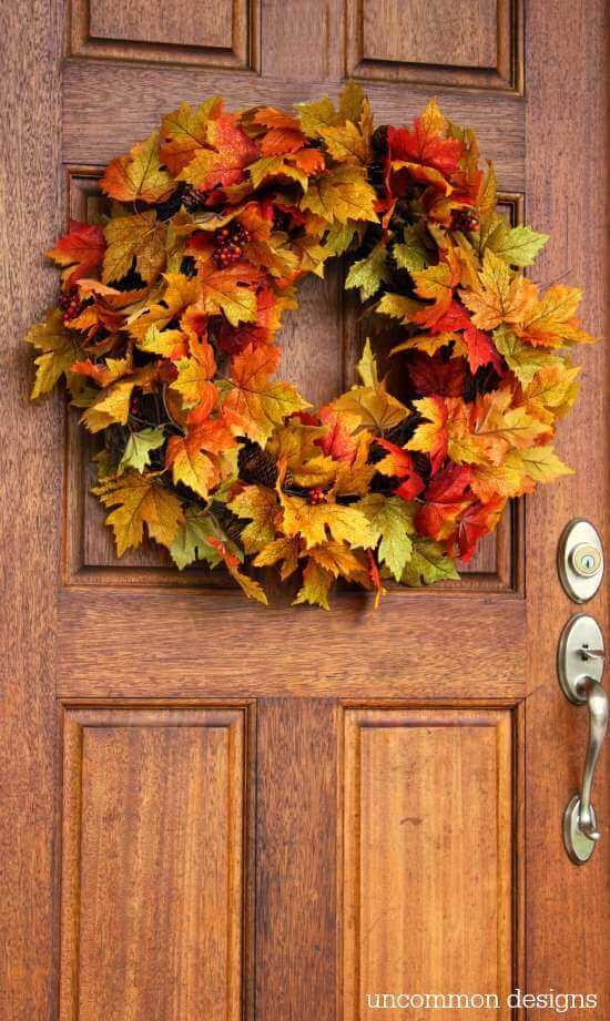 For a cozy way to welcome your guests, hang a wreath made out of leaves on your front door.