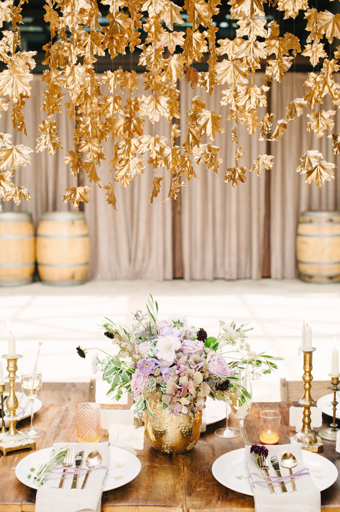 For a truly stunning tablescape, spray paint leaves and hang them from the ceiling over your dining table.