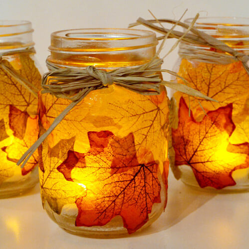 With a little Mod Podge, you can make these cute leafy mason jar candle holders.