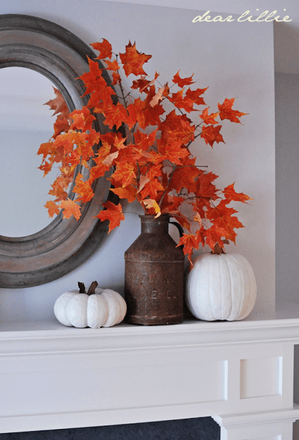 To dress up your mantel, simply put some branches with leaves in a vase.