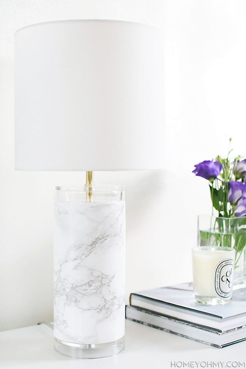 Easy and cheap, you can add a hint of marble on a lamp you already have.