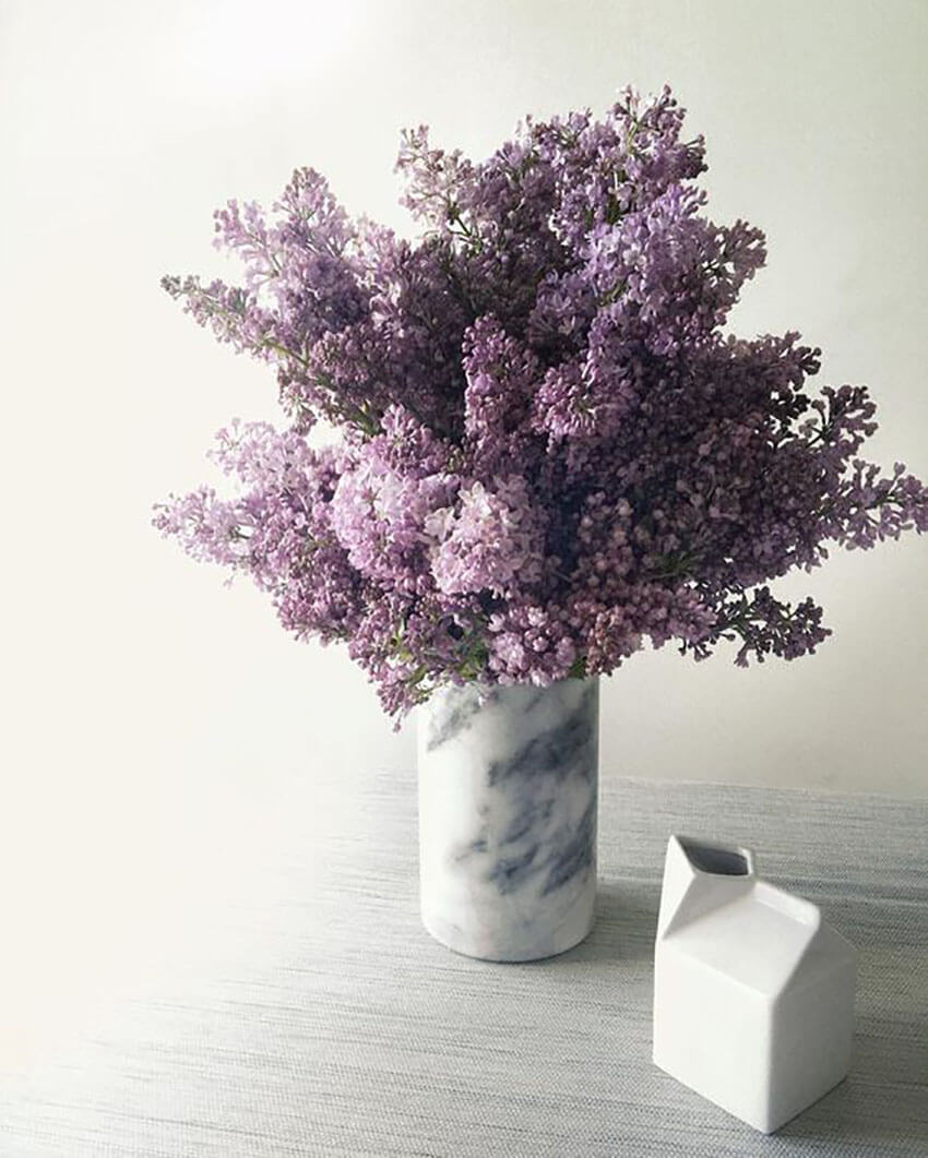 You can transform your vases with marble contact paper.
