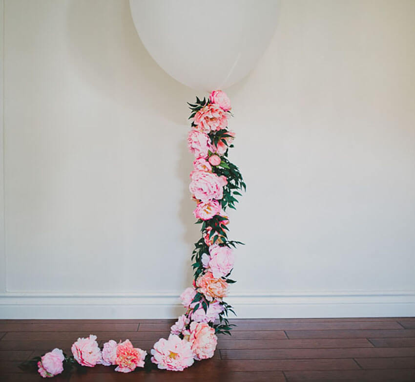 A floral balloon is a great, unexpected way to decorate with flowers.