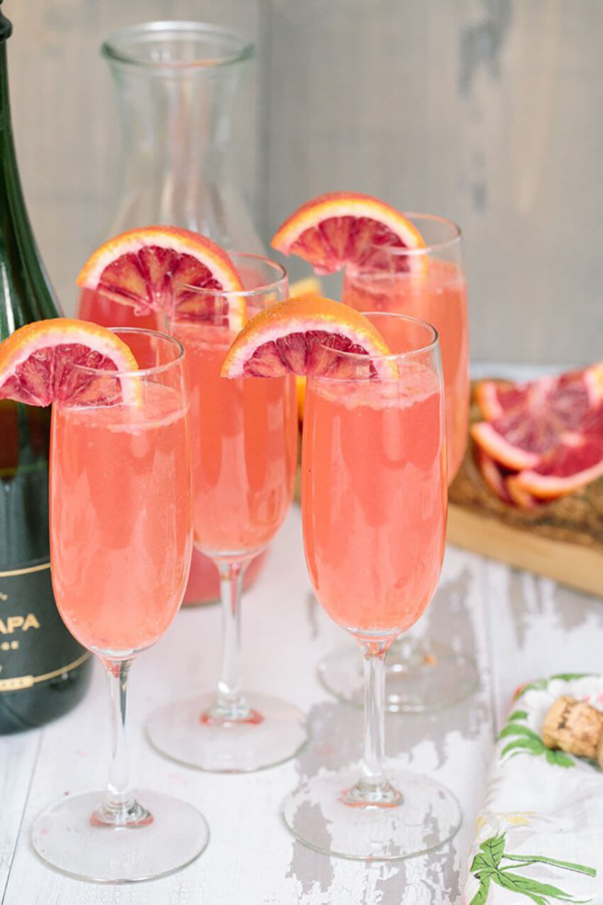 Blood oranges bring a beautiful color to these mimosas.
