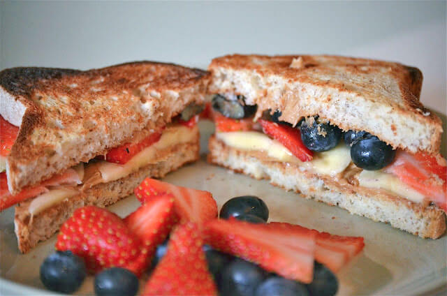 Instead of using sugary preserves, opt for using fresh fruits in your PB&J!