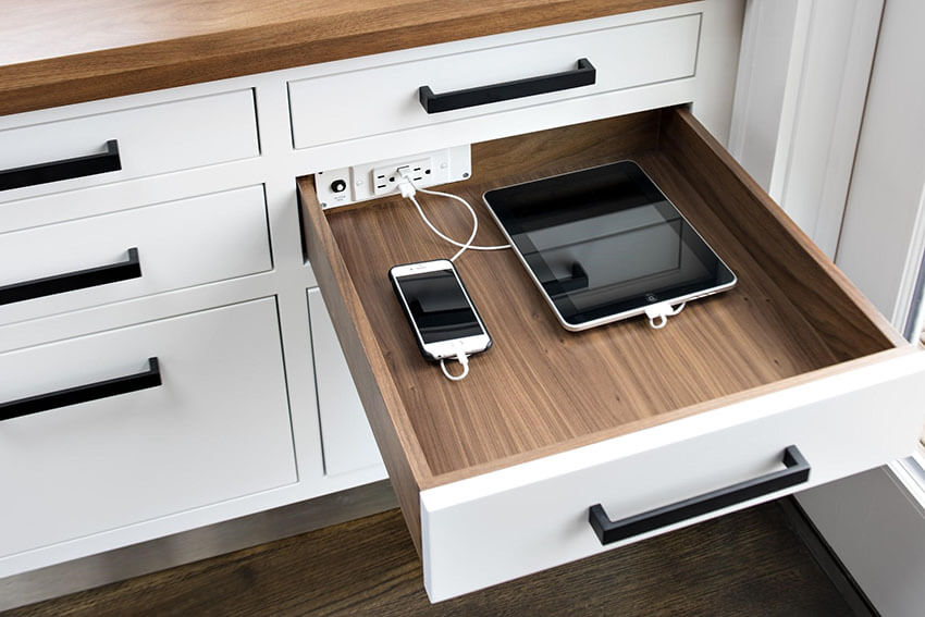 Charge your electronics in a drawer to maintain the table clean and organized.