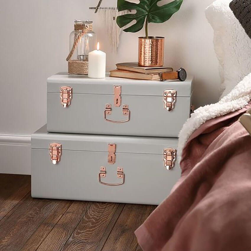 Use small trunks for extra storage beside the bed.