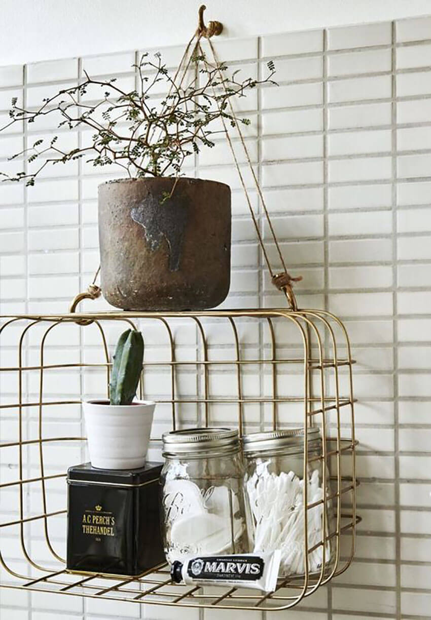 Hang wire baskets in the bedroom to free some space under the sink.