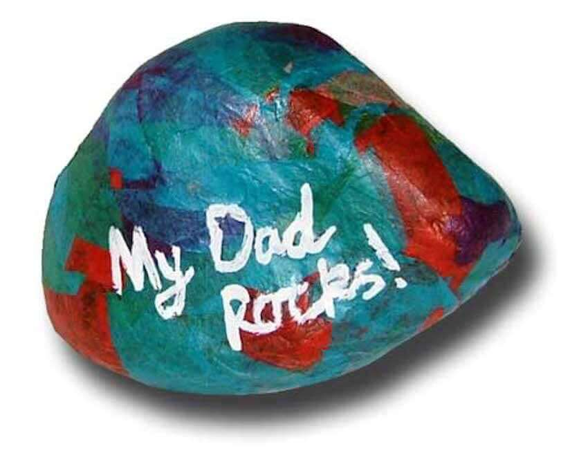 Grab your acrylic paints and your kids and head out to find the perfect rock for your kids to paint for their dad! They get to be creative and messy and dad gets a sweet gift from his kids! It's perfect (and so inexpensive)!