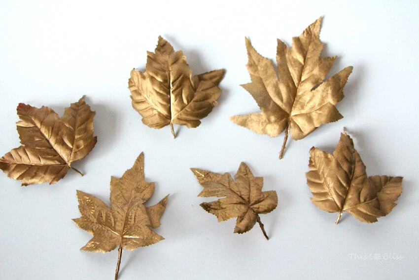 Golden leaf decor makes the dining room feel that much classier