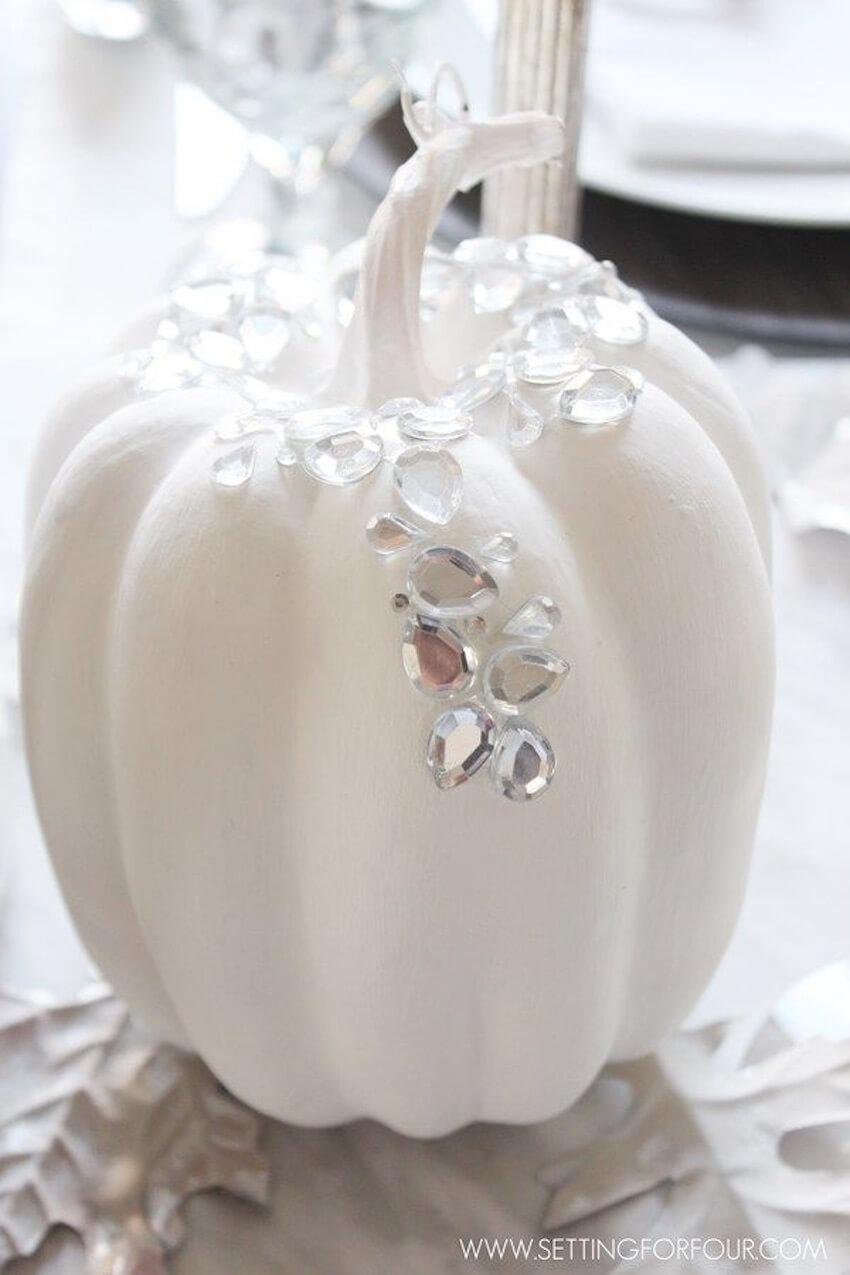 A giant white pumpkin says fall decor