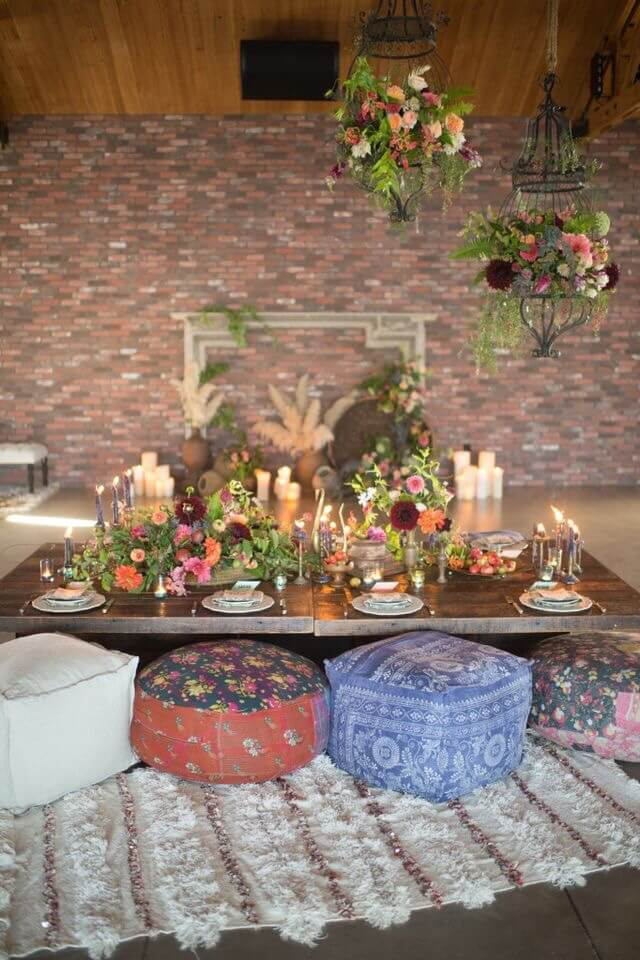 Using poufs as seating around a table creates an intimate, cozy atmosphere.
