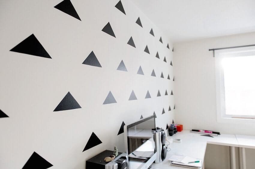 Interior wall design with triangles and shapes