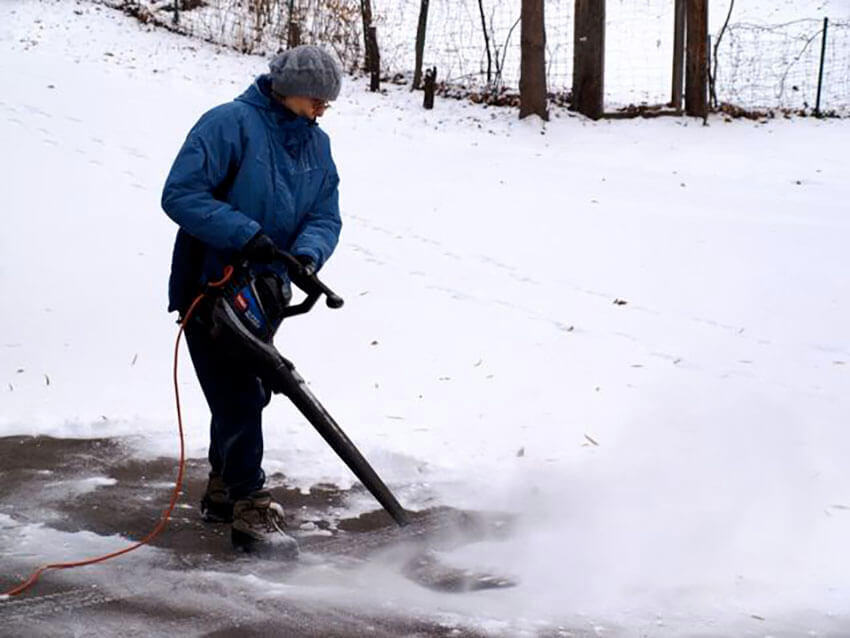 Make the leaf blower work double shift by using it to blow away light snow.