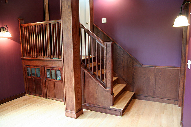 Stairs can change the look and feel of a room depending on the materials, colors, and shape.