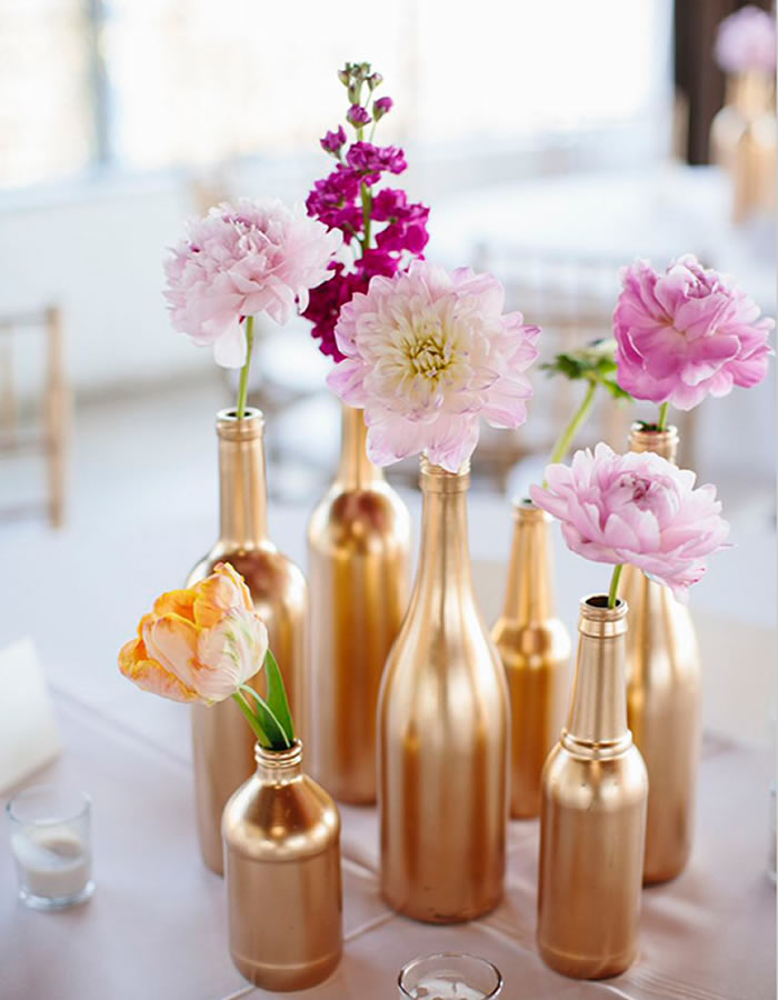 Transform empty bottles into stunning tabletop decorations with a little spray paint.