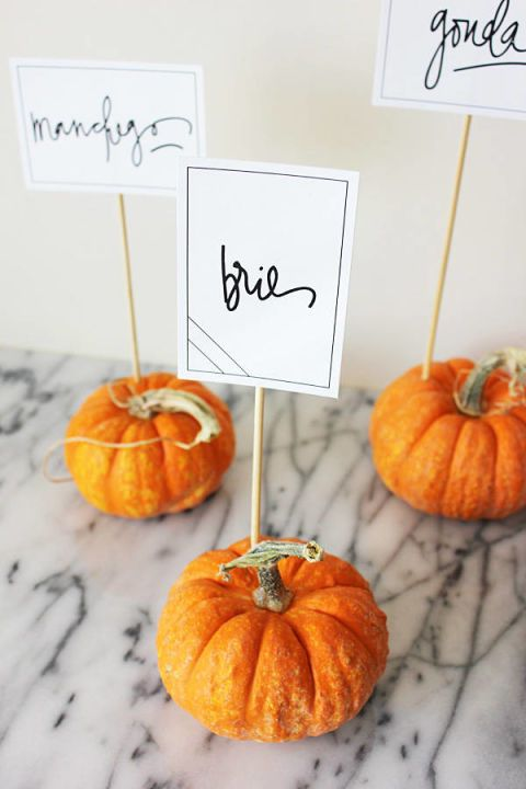 These adorable pumpkin place holders will make your guests smile and feel welcome.