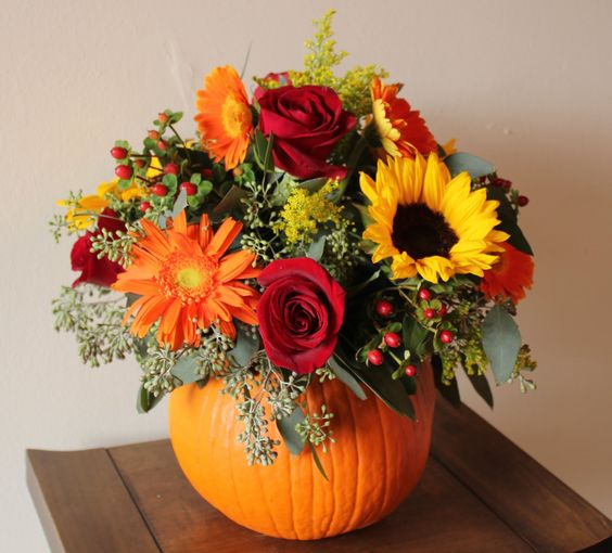 To create a beautiful bouquet for your table, all you need is a great vase (or pumpkin) and some fall-colored flowers.