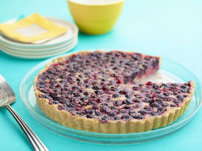 This new twist on the classic lemon tart uses fresh blueberries to give it a hint of sweetness.