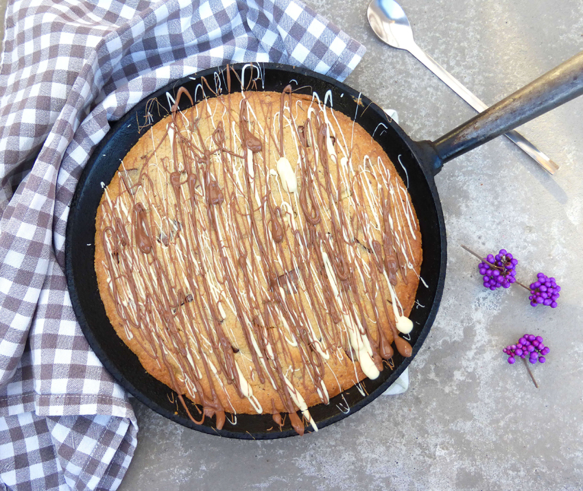 You absolutely need to try this delicious, huge, gluten free double chocolate chunk skillet cookie!