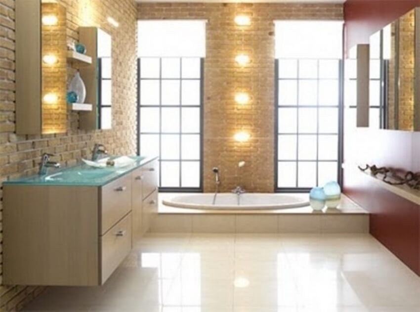 Marquee lights bathroom with exposed brick