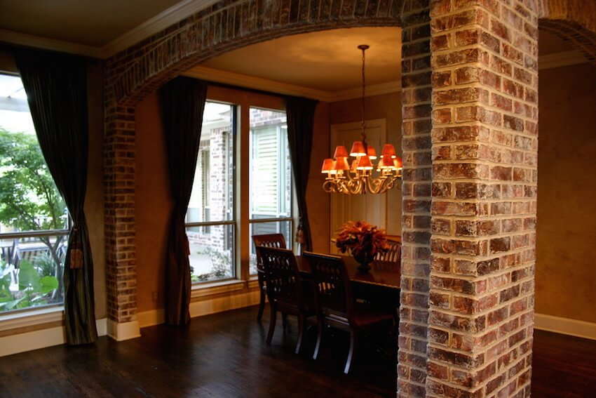Old-world style exposed brick dining room