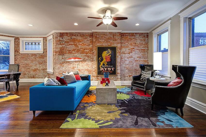 Colorful living room with exposed brick walls
