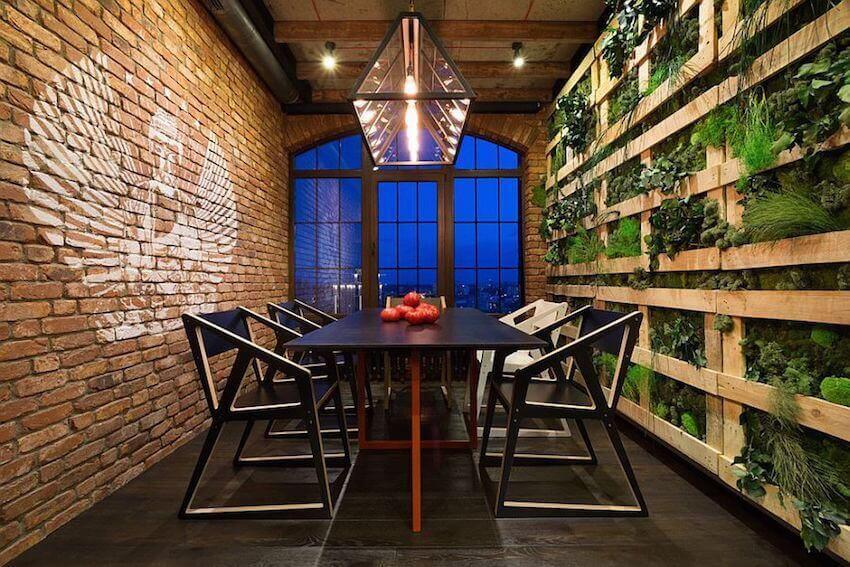 Exposed brick and living wall dining room