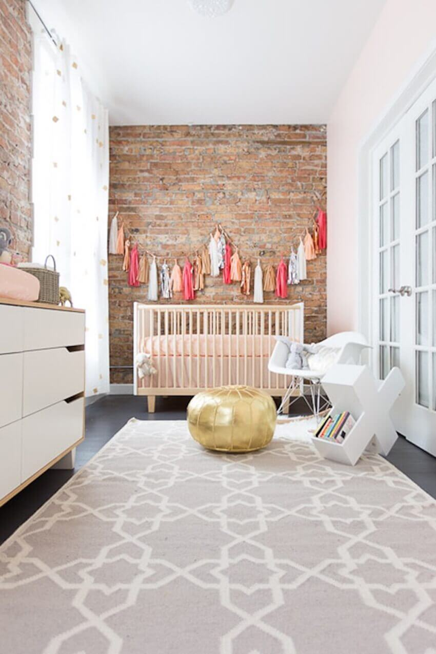 Nursery room with exposed brick wall