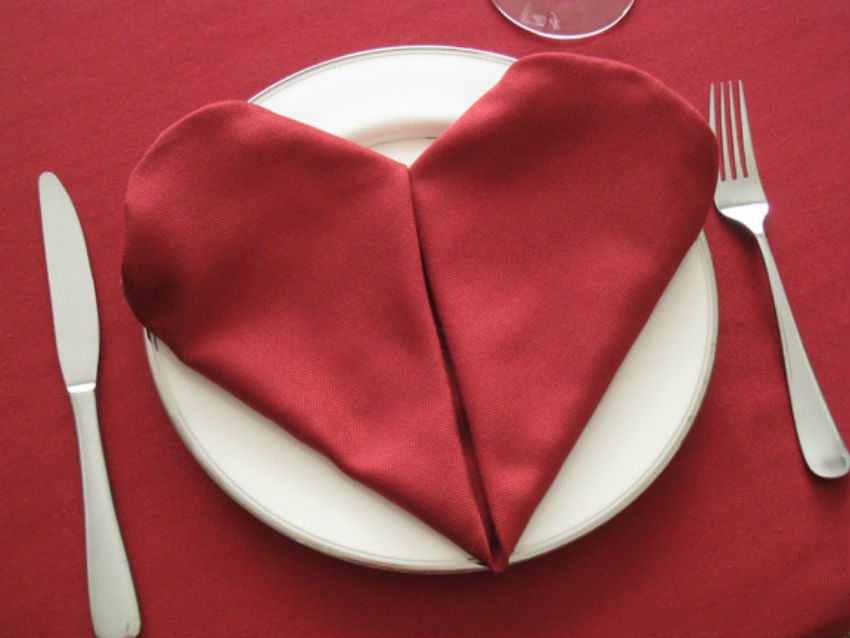 You can learn how to fold napkins into hearts. Image Source: Vegetable Fruit Carving