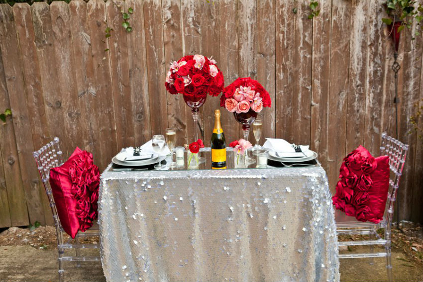 This silver spangled tablecloth will make the red accents pop. Image Source: Lockerdome