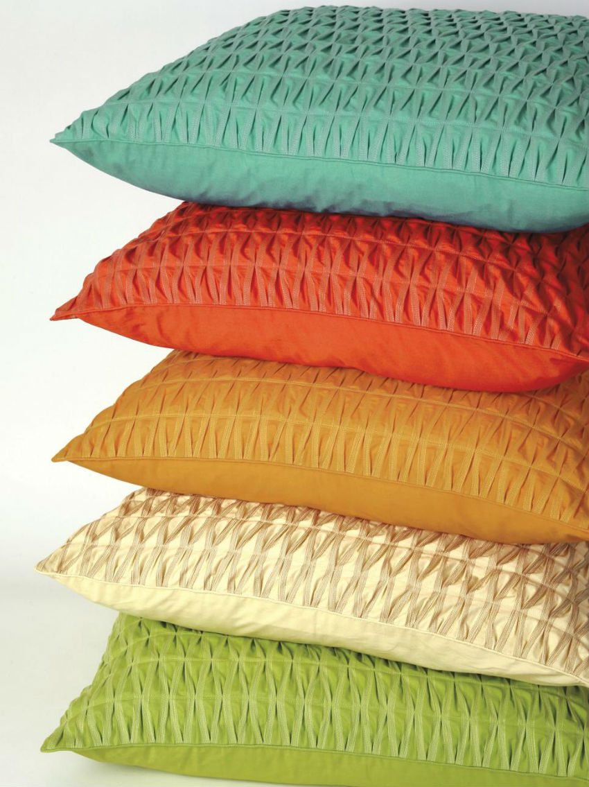 Bright pillows will make winter feel hotter. Image Source: Company C