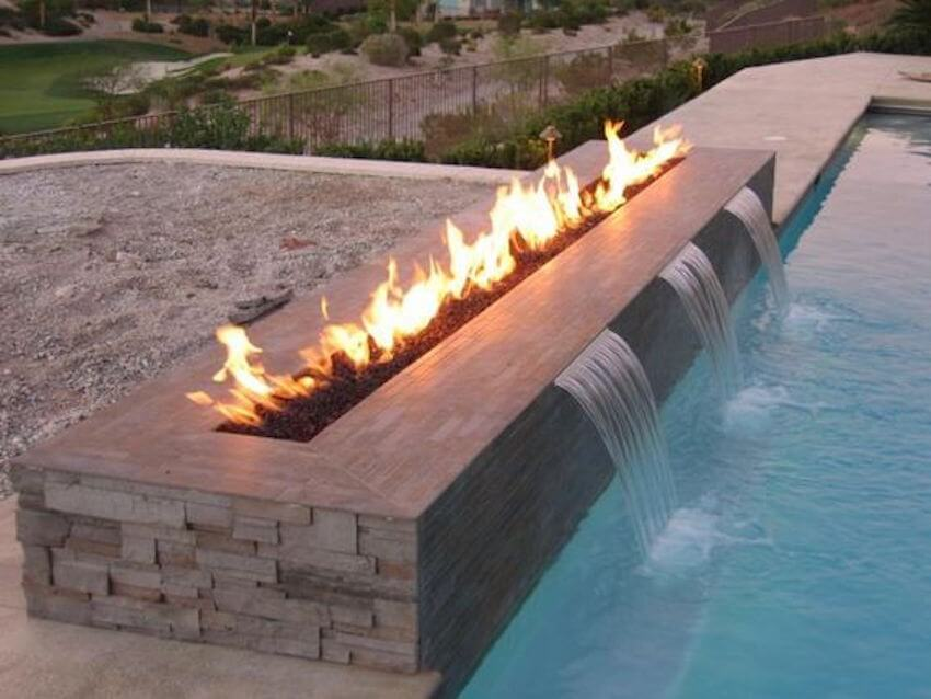 Adding a waterfall onto your swimming pool is a great way to enhance the aesthetics of your backyard.