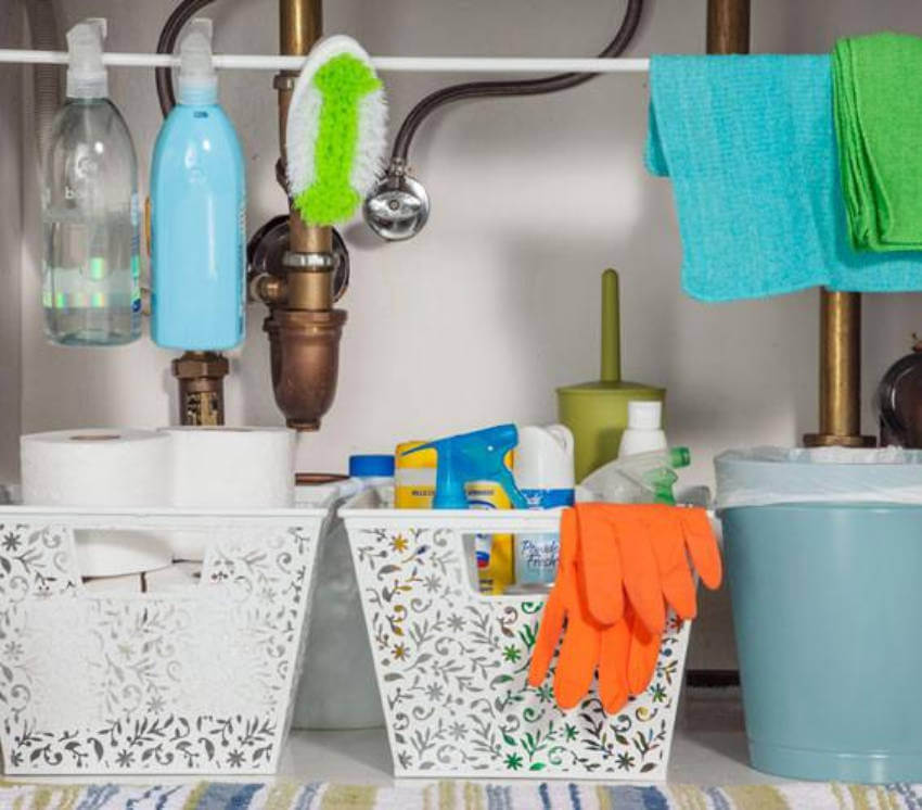 Using a rod under your kitchen sink saves space and keeps it more organized!