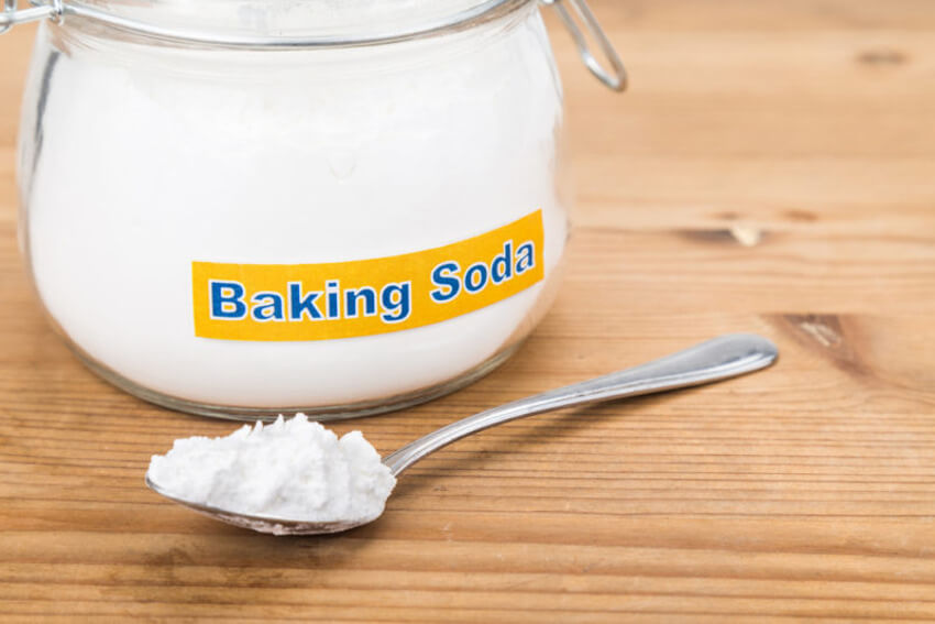 Fill in the driveway or sidewalks cracks with baking soda.