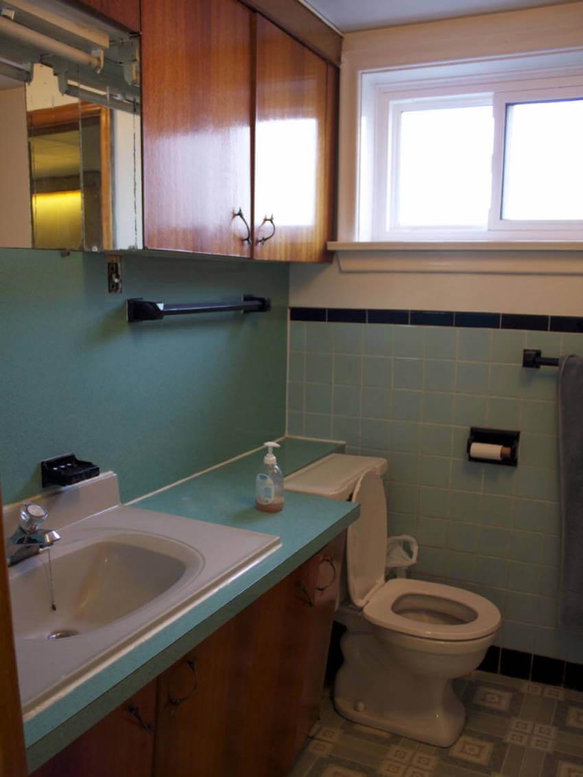 Bathroom with blue walls badly lit.