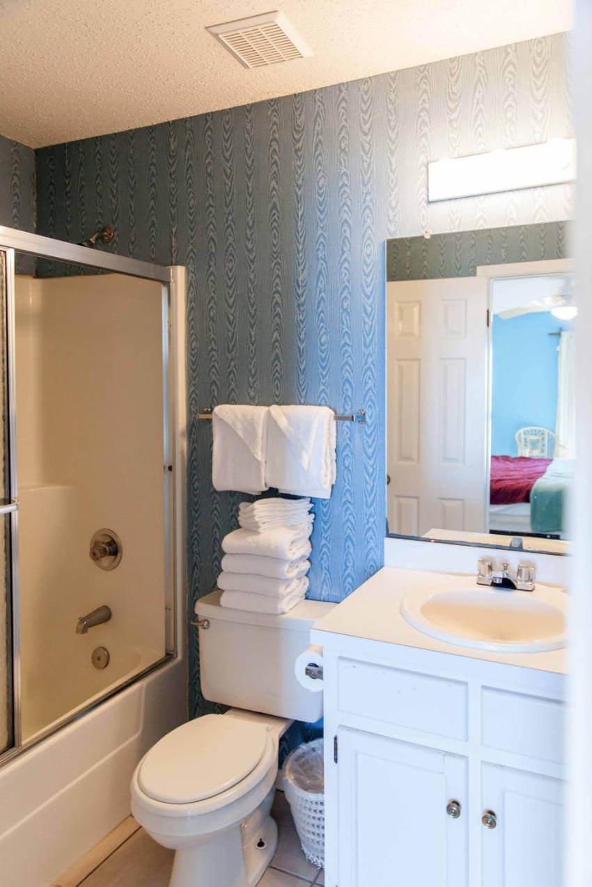Cluttered looking bathroom.