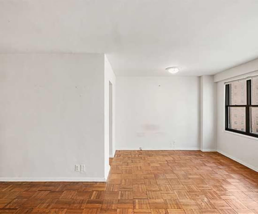 White walls and parquet flooring don't create anything too special by themselves.