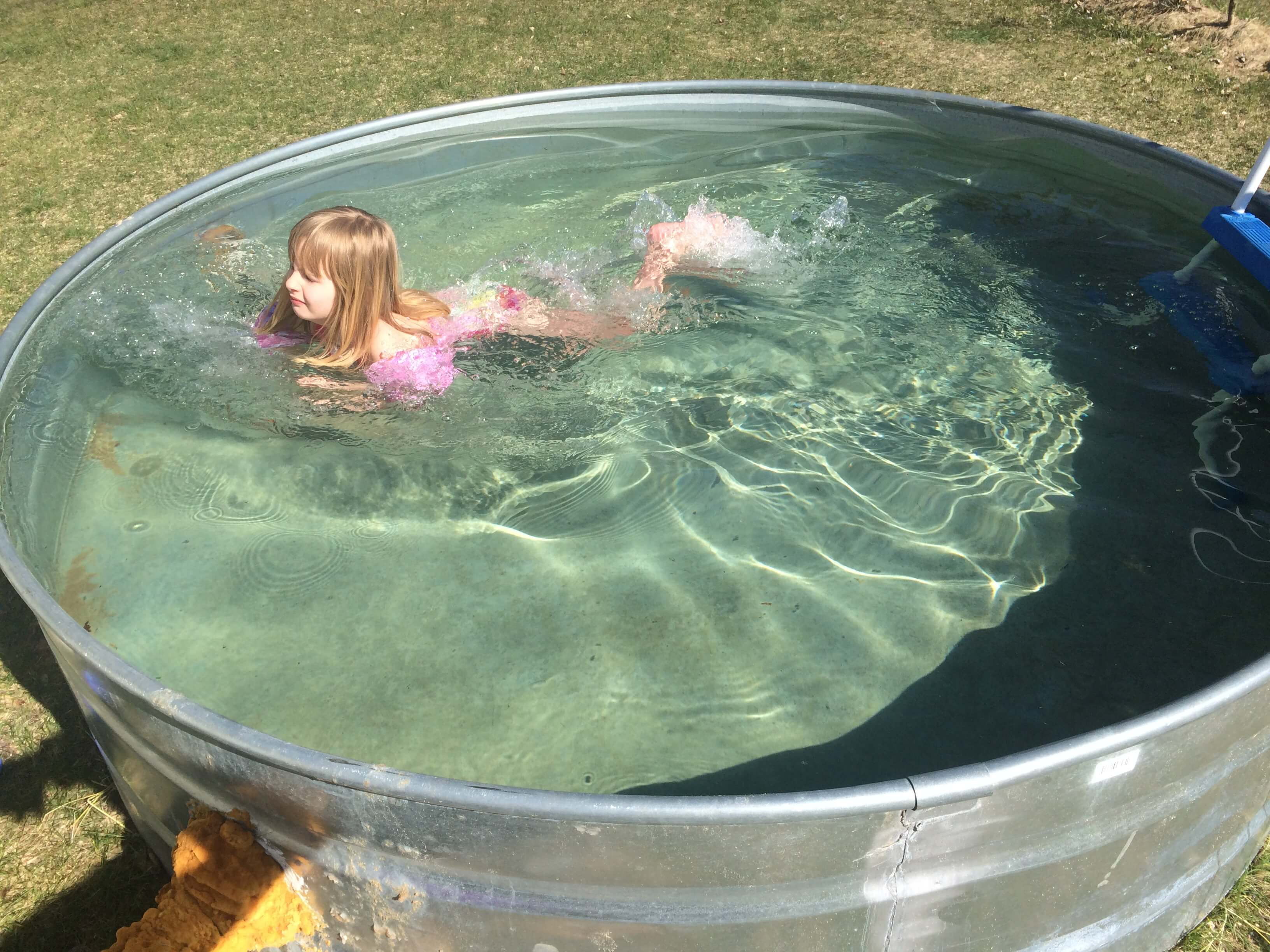 Little kids love the stock tank pool!