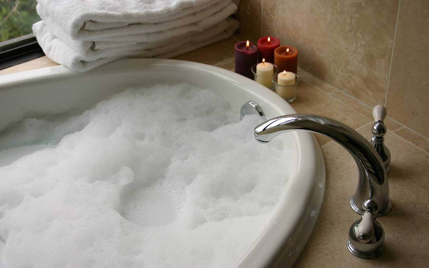 Add some candles around your bathtub to set a more relaxing mood!