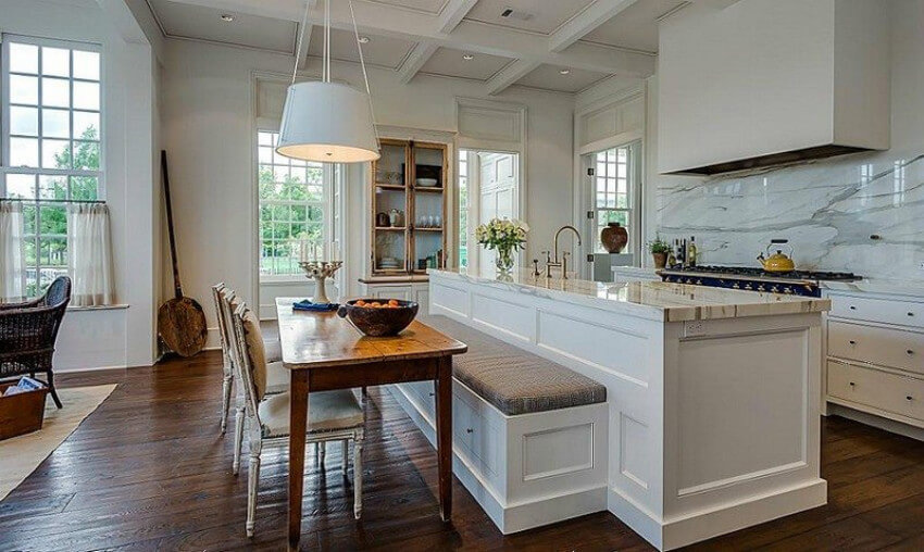 Attaching a breakfast nook to the kitchen island can be really practical.