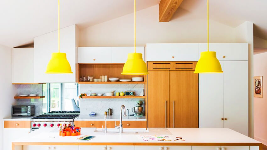 These yellow light fixtures are super classy and modern-looking!