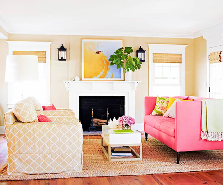 A pink couch with some neutral general decor can easily lighten up the mood!