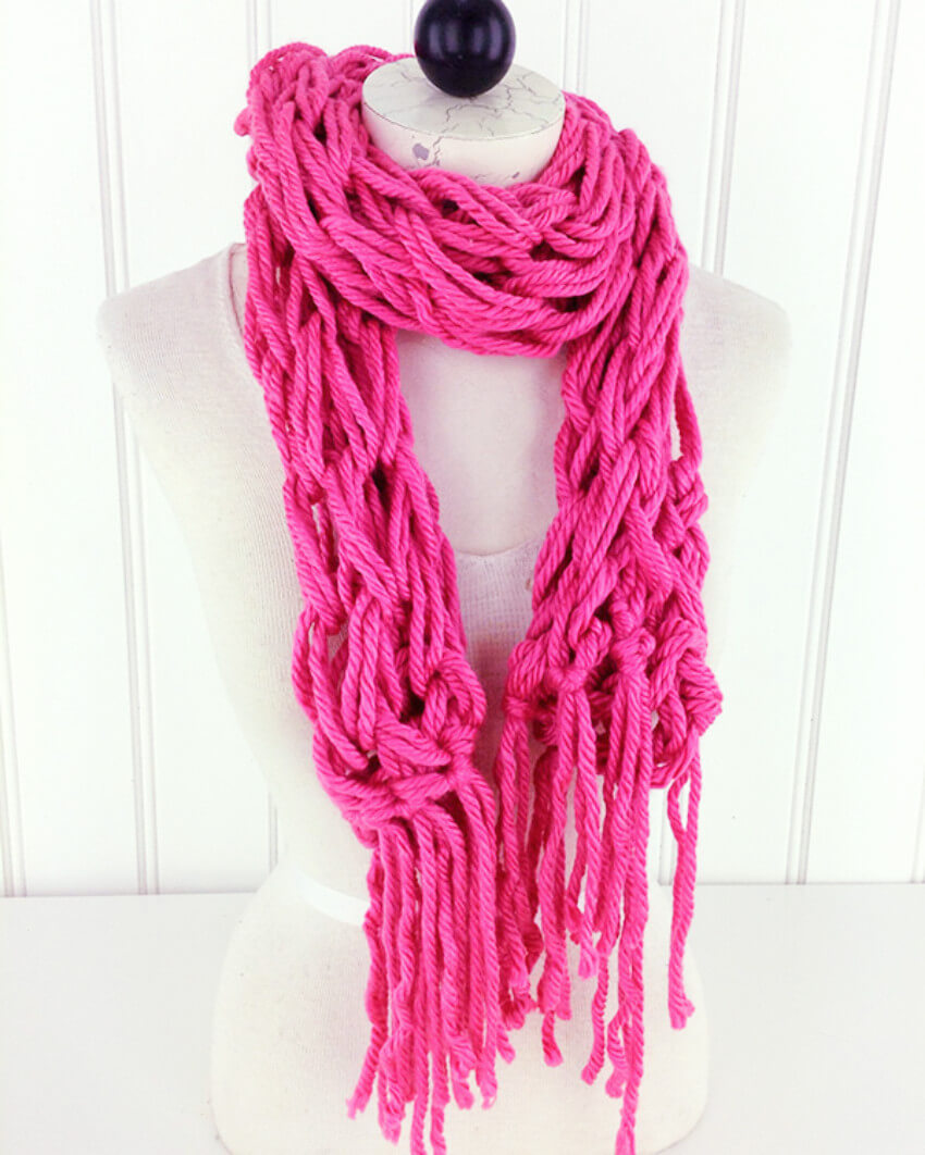 This pink arm-knit scarf will definitely make your winter better!