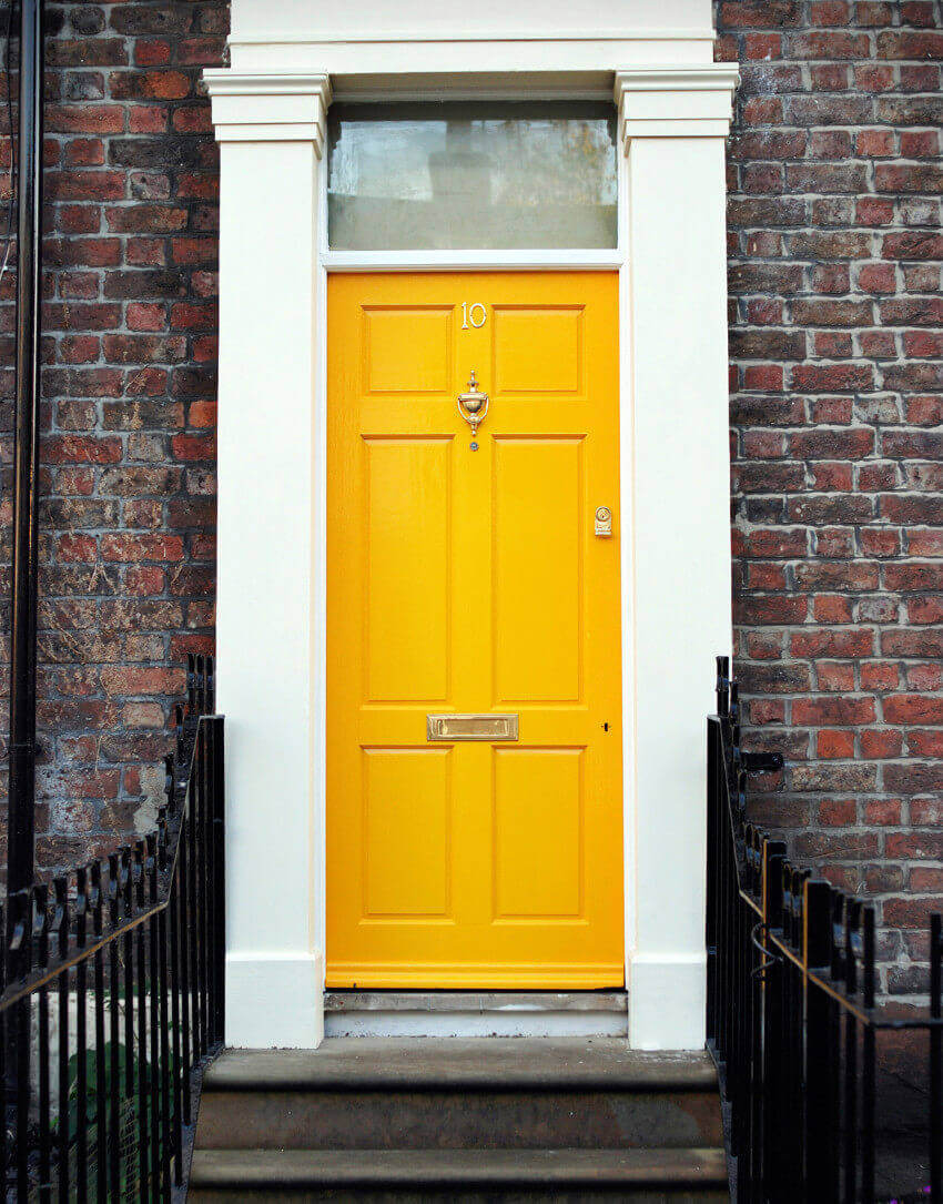 A yellow door adds major curb appeal and it's super unique!