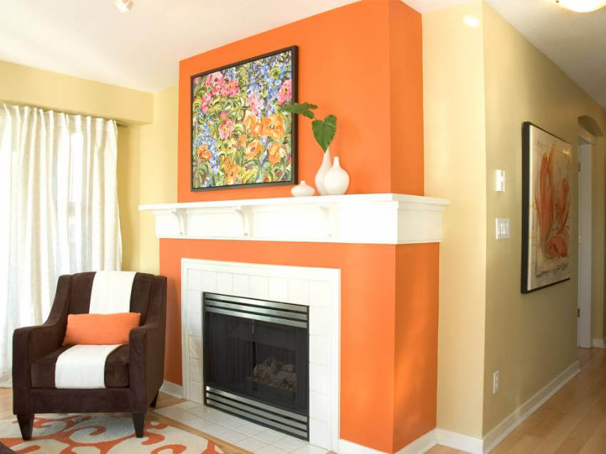 Orange is a beautiful color to give your fireplace a revamp!