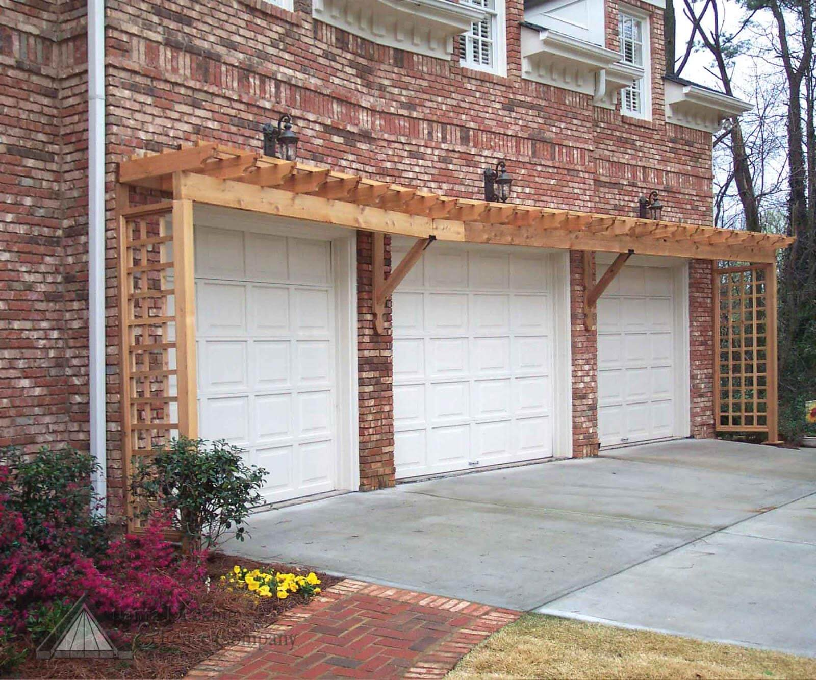 Even brick garages can benefit from a pergola built into them.
